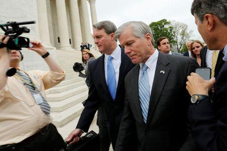 Former Virginia Governor Bob McDonnell (C) is trailed by reporters as he departs after his appeal of his 2014 corruption conviction was heard at the U.S. Supreme Court in Washington, U.S. April 27, 2016. REUTERS/Jonathan Ernst