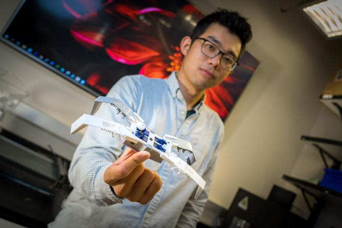 Flexoskeleton-based soft robot held by James Jiang