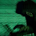 Britain investigating whether leaked trade papers were hacked - sources