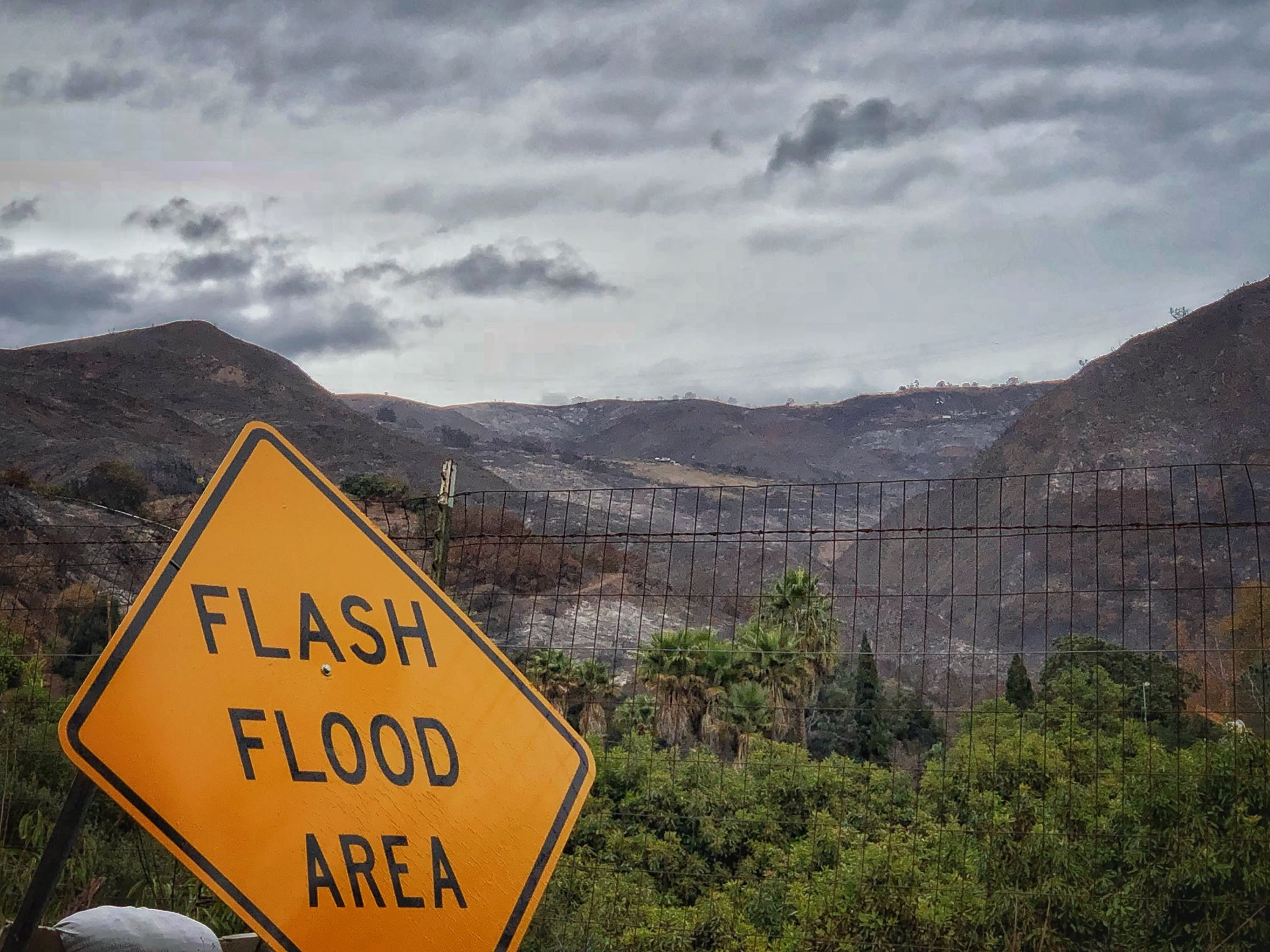 <p>A flash flood area sign is posted, as evacuations have been issued for several fire-ravaged communities in Santa Barbara, Calif., Monday, Jan. 8, 2018. (Photo: Mike Eliason/Santa Barbara County Fire Department via AP) </p>