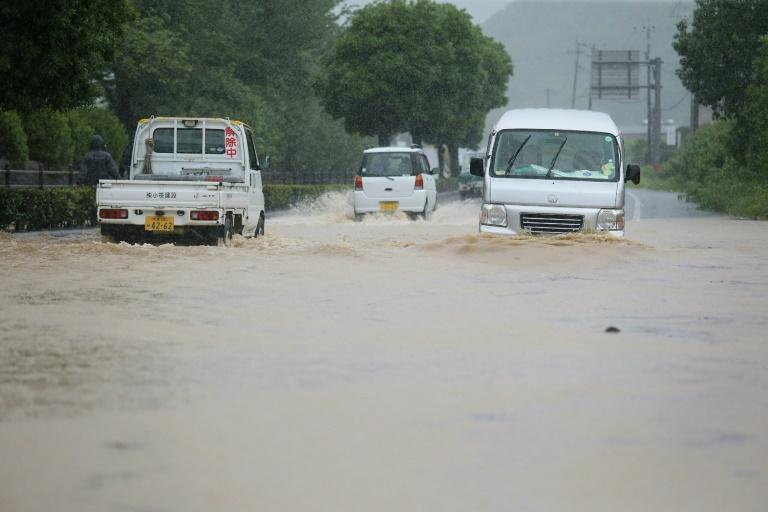 Reports said 75,000 residents were ordered to evacuate their homes, with nearly 100 people stranded (AFP Photo/STR)