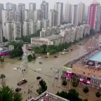 Migrant workers stranded in China's flooded cities
