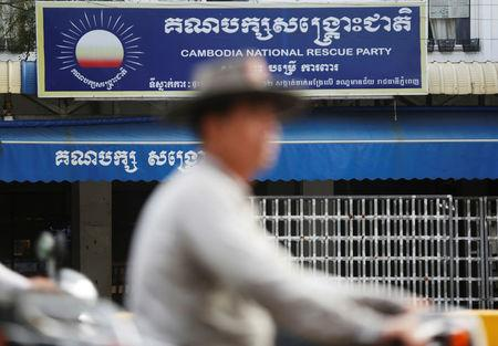 A man rides a motorcycle past the Cambodia National Rescue Party (CNRP) headquarters in Phnom Penh, Cambodia, November 17, 2017. REUTERS/Samrang Pring