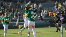 Athletics win 11th straight game on bases-loaded, extra-innings error