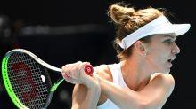 Halep shrugs off 'stress' to race into Australian Open quarter-finals