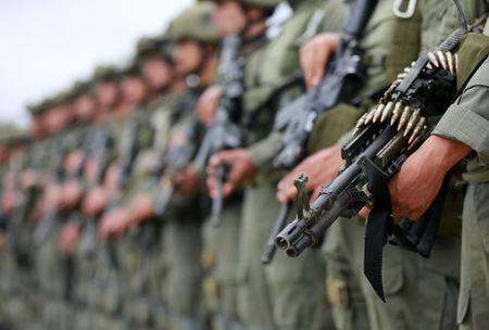 Colombian anti-narcotics police officers stand in formation before the embarking on anti-narcotics operations in San Jose del Guaviare, Colombia, August 2, 2016. REUTERS/John Vizcaino