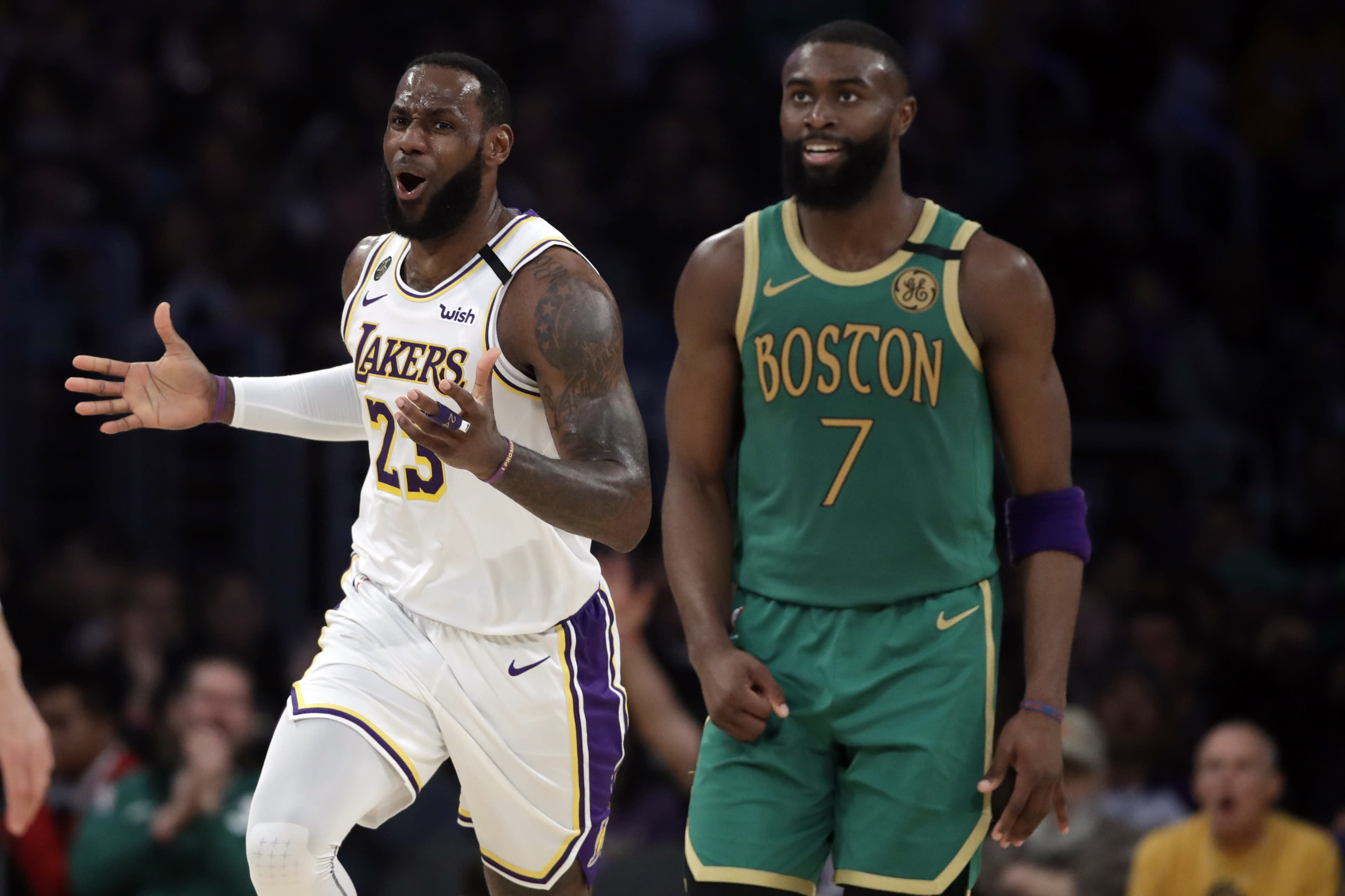 Los Angeles Lakers' LeBron James (23) argues a call next to Boston Celtics' Jaylen Brown (7) during the first half of an NBA basketball game Sunday, Feb. 23, 2020, in Los Angeles. (AP Photo/Marcio Jose Sanchez)