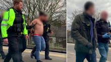 Pictured: Moment police capture topless man who stormed on to packed train with a knife