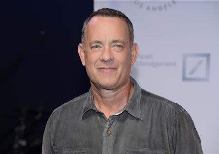 """File photo of Tom Hanks attending The Shakespeare Center of Los Angeles 23rd Annual Simply Shakespeare benefit reading of """"The Two Gentlemen of Verona"""" in Santa Monica"""
