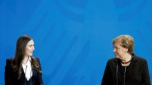 German conservative big guns rally behind Merkel