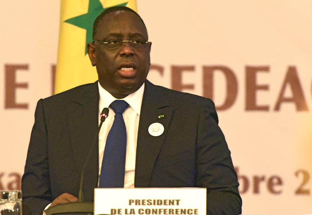 Senegal's president Macky Sall, also president of the The Economic Community of West African States (ECOWAS or CEDEAO in French) delivers the opening speech of the ECOWAS head of states extaordinary summit in Dakar on September 12, 2015