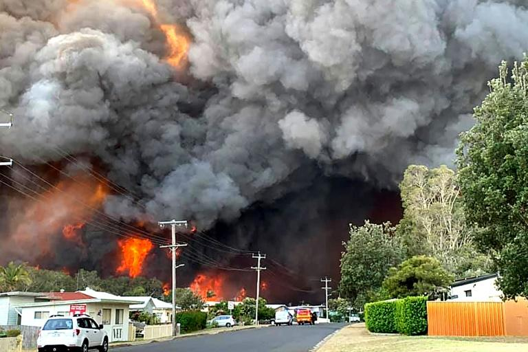 An out-of-control bushfire burns in Harrington, some 335 kilometres (210 miles) northeast of Sydney (AFP Photo/Kelly-ann Oosterbeek)