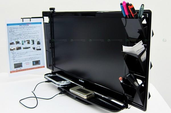 Thanko's monitor hub takes all your desk clutter and hangs it from your LCD