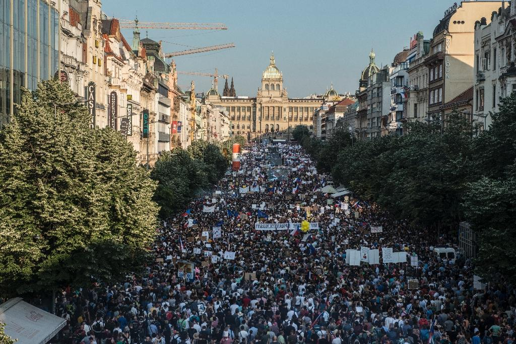 """""""Andrej Babis gives us a new reason to protest every week,"""" Benjamin Roll of the Million Moments for Democracy NGO, one of the organisers, told the protesters at the biggest demonstration the country has seen in decades. """"We've had enough"""" (AFP Photo/Michal Cizek)"""