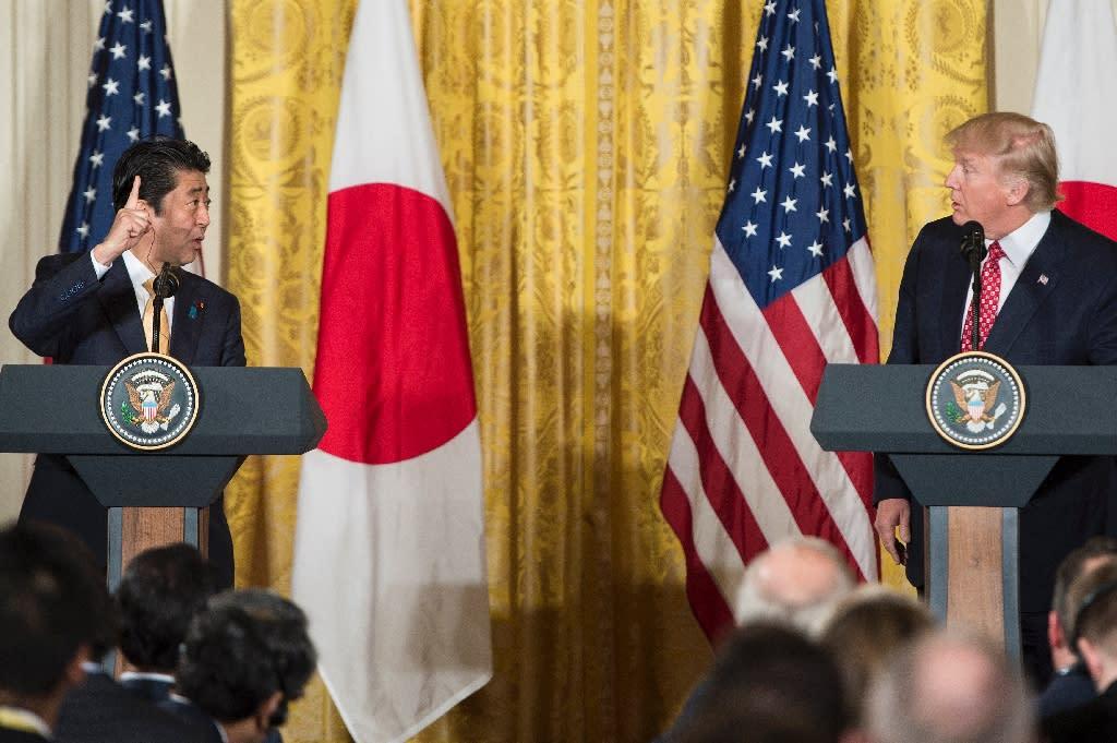 "US President Donald Trump praised the ""very, very good chemistry"" between himself and Japanese Prime Minister Shinzo Abe (AFP Photo/Brendan Smialowski)"