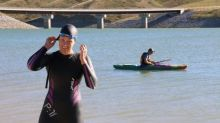 Woman swims across reservoir that supplies her city's water to protest coal mines that could put it at risk