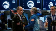 Wall St ekes out small gain as earnings offset cost worries