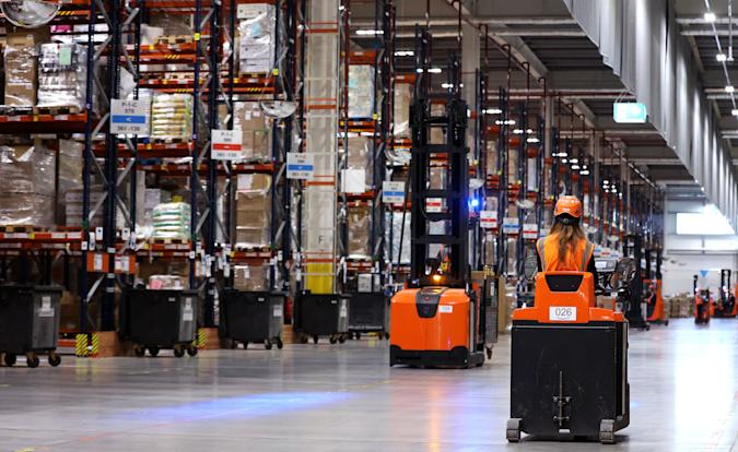 Employees work at the Amazon logistics centre in Suelzetal near Magdeburg, eastern Germany, on Mai 12, 2021. - The US online sales giant had opened the new warehouse in Saxony-Anhalt in August 2020. (Photo by Ronny Hartmann / AFP) (Photo by RONNY HARTMANN/AFP via Getty Images)