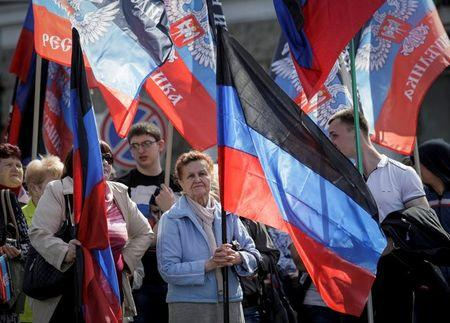 People carry flags of the self-proclaimed Donetsk People's Republic as they attend a rally dedicated to the second anniversary of the republic's founding in Donetsk, Ukraine, April 9, 2016. REUTERS/Alexander Ermochenko/File Photo
