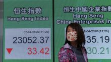 Asian stocks mixed as economic toll of virus worsens