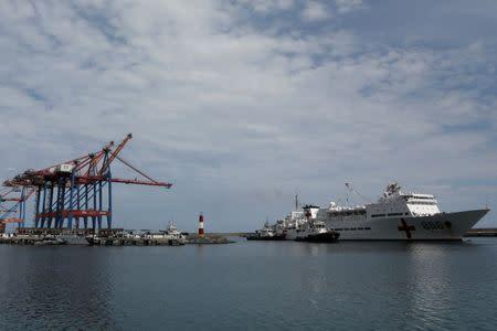 China's People's Liberation Army (PLA) Navy hospital ship Peace Ark, prepares to dock at the port in La Guaira, Venezuela September 22, 2018. REUTERS/Manaure Quintero