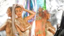 Kim Kardashian shares behind-the-scenes shots from topless glitter shoot