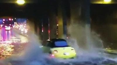 Raw: Extra heavy rains close roads in Seattle