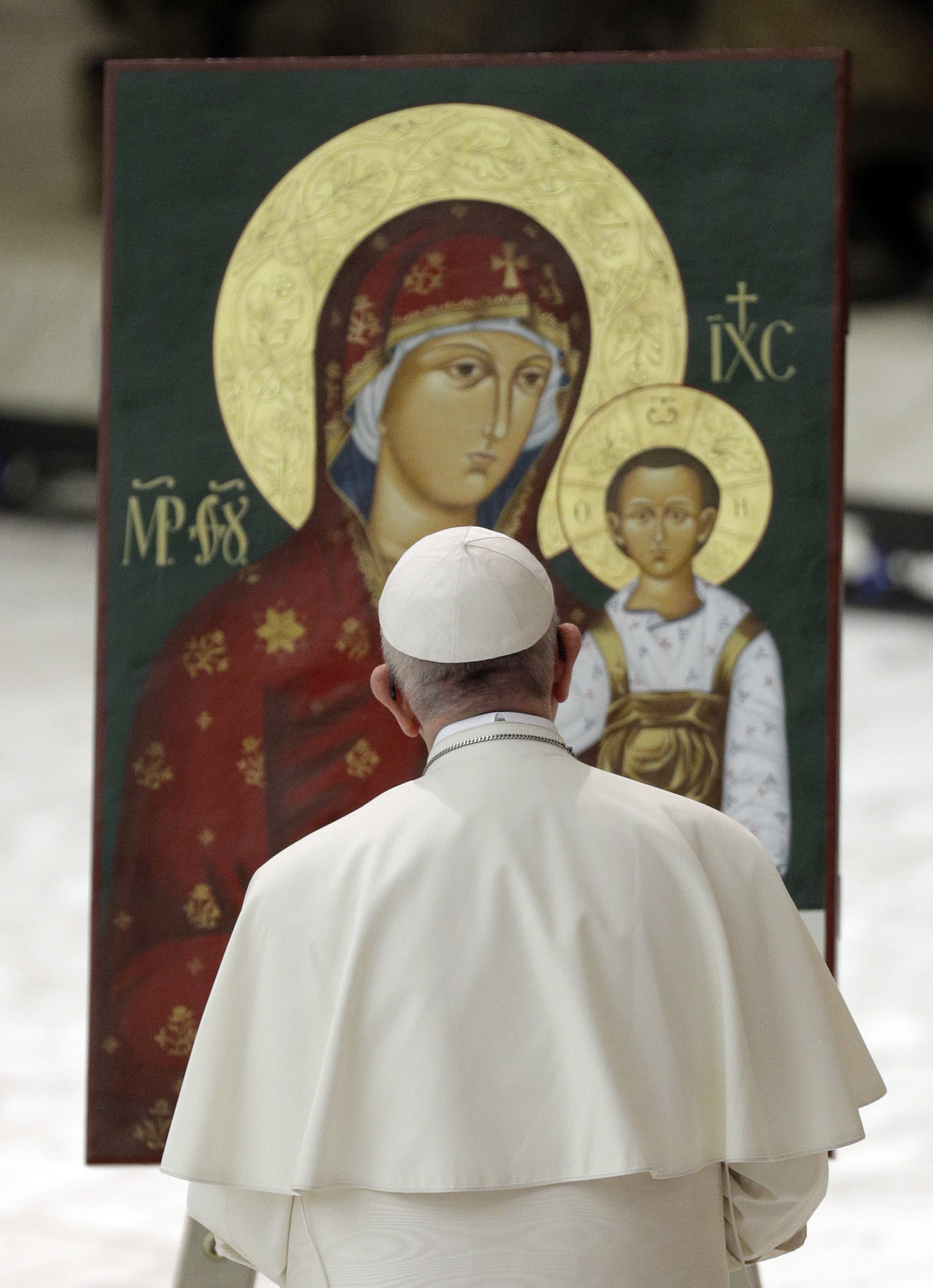 Pope Francis prays in front of an icon of the Virgin and baby Jesus during an audience with pilgrims from Slovakia in the Paul VI Hall at the Vatican, Saturday, Oct. 6, 2018. (AP Photo/Gregorio Borgia)