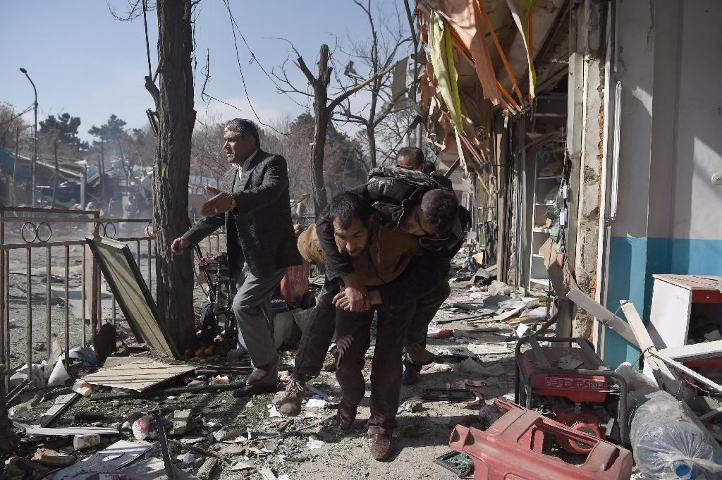 The scene of a car bomb attack in Kabul on January 27, 2018, which was claimed by the Taliban (AFP Photo/WAKIL KOHSAR)