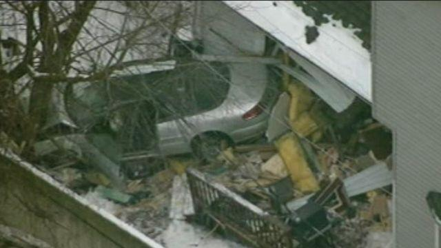 Out-of-control car crashes through house
