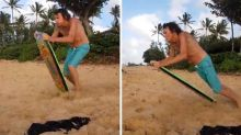 Grandad faceplants hard on sand while trying sandboarding