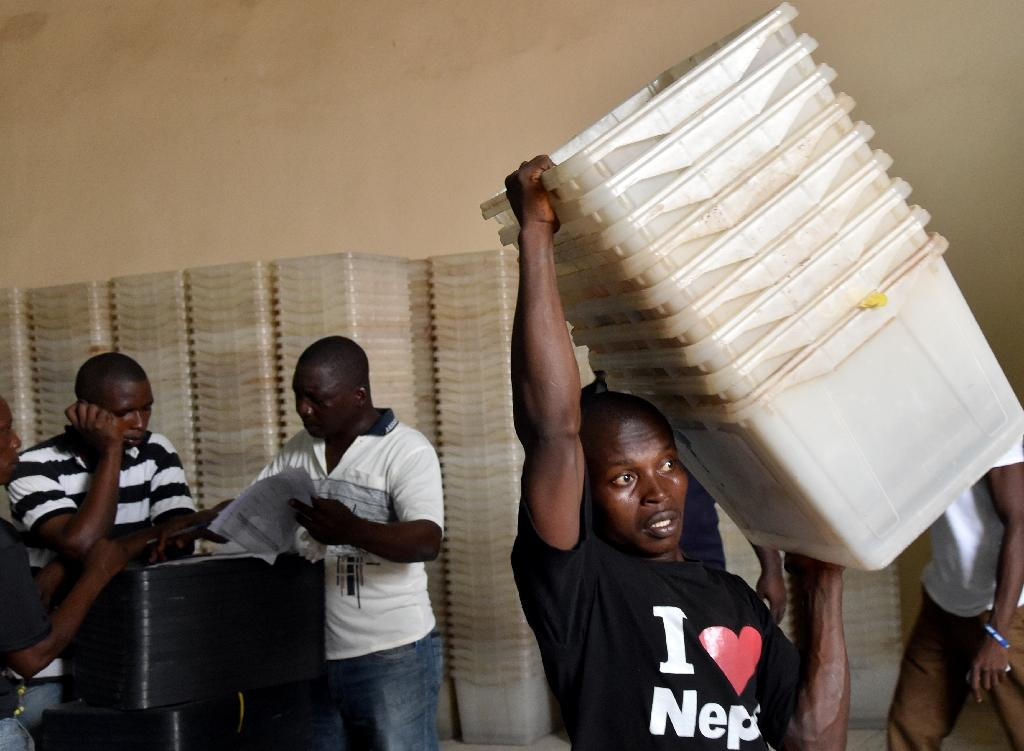 Gearing for the vote: Ballot boxes in the Electoral Commission's warehouse near Freetown are prepared for distribution (AFP Photo/ISSOUF SANOGO)