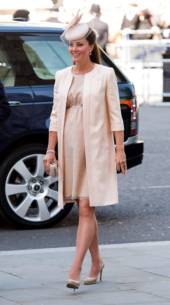 Kate looked positively lovely at the Queen's Coronation service in one of her favorite designers, Jenny Packham, a light peach, almost nude lace empire-waisted dress.