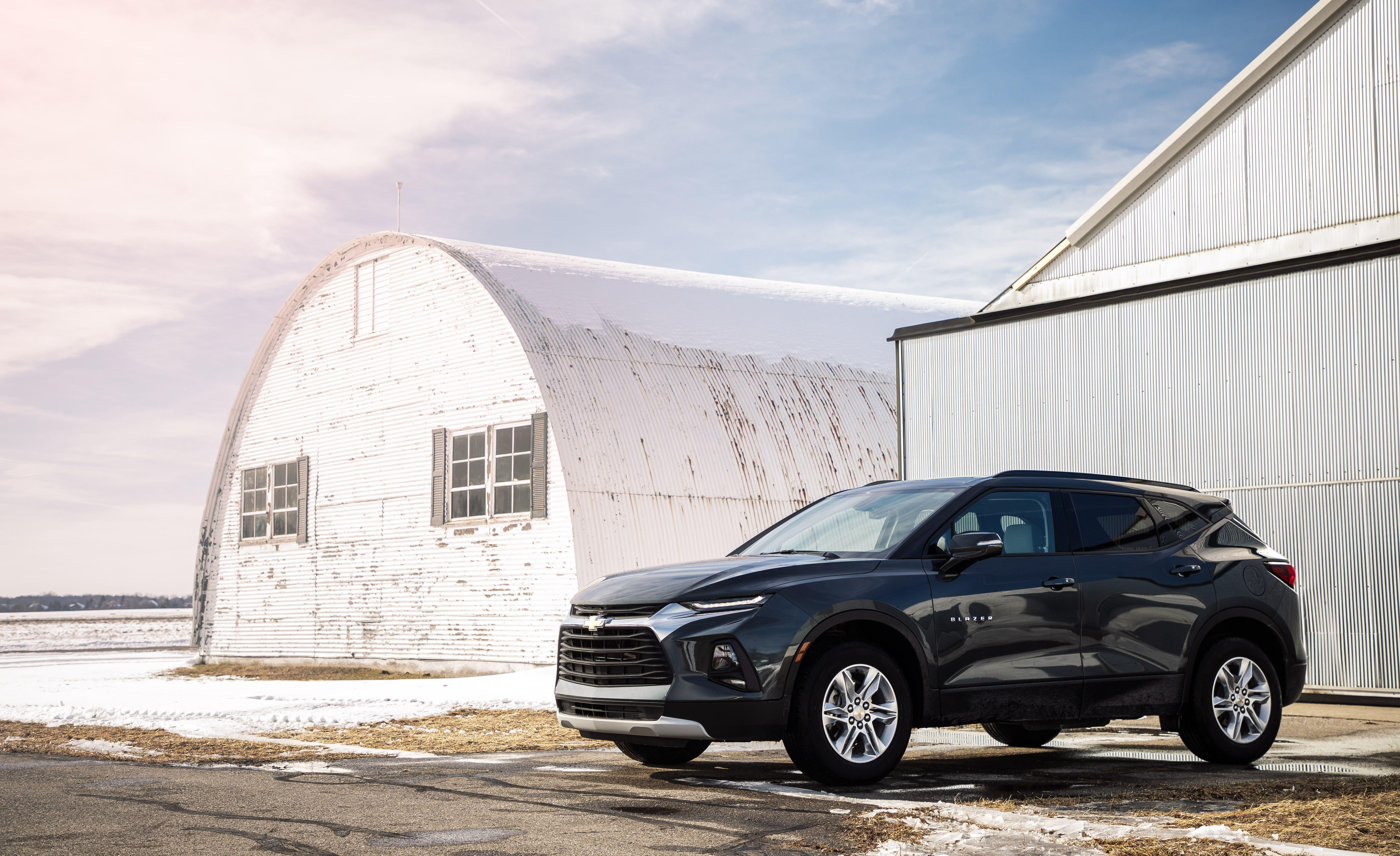 "<p>Chevrolet resurrects the Blazer nameplate for 2019, but this all-new crossover prioritizes style over the ruggedness of its legendary off-road predecessors. The two-row Blazer is positioned between <a href=""https://www.caranddriver.com/chevrolet/equinox"" rel=""nofollow noopener"" target=""_blank"" data-ylk=""slk:the compact Chevy Equinox"" class=""link rapid-noclick-resp"">the compact Chevy Equinox </a>and <a href=""https://www.caranddriver.com/chevrolet/traverse"" rel=""nofollow noopener"" target=""_blank"" data-ylk=""slk:the three-row Chevy Traverse"" class=""link rapid-noclick-resp"">the three-row Chevy Traverse</a>. Its mid-size classification pits it head to head against other two-row rivals such as <a href=""https://www.caranddriver.com/ford/edge"" rel=""nofollow noopener"" target=""_blank"" data-ylk=""slk:the Ford Edge"" class=""link rapid-noclick-resp"">the Ford Edge</a> and <a href=""https://www.caranddriver.com/honda/passport"" rel=""nofollow noopener"" target=""_blank"" data-ylk=""slk:the Honda Passport"" class=""link rapid-noclick-resp"">the Honda Passport</a>. While the Blazer is available with a potent 308-hp V-6 engine and all-wheel drive, entry-level models such as the one we tested for this review are available only with front-wheel drive and a dutiful 193-hp four-cylinder. We'll detail much of the content and capabilities that make this Blazer so budget friendly.</p>"
