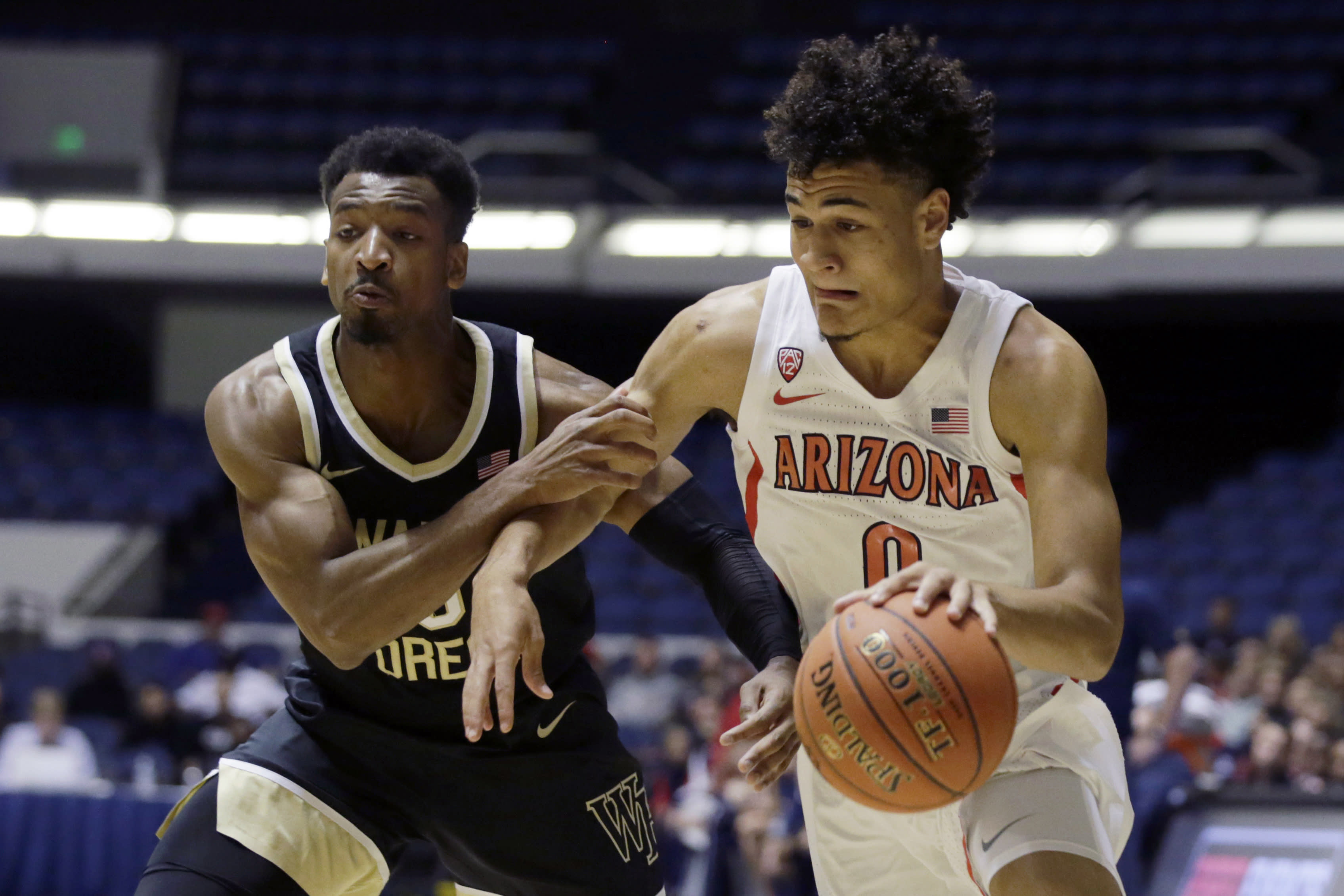 Arizona guard Josh Green, right, drives to the basket against Wake Forest guard Andrien White during the first half of an NCAA college basketball game at the Wooden Legacy tournament in Anaheim, Calif., Sunday, Dec. 1, 2019. (AP Photo/Alex Gallardo)