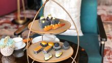 MO Bar's new afternoon tea gives savory and sweet nibbles a black and gold makeover