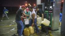 Unrest over Mexico gasoline price hike erupts into looting