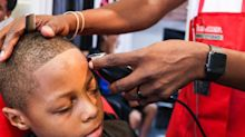 How free haircuts make kids feel good about going back to school