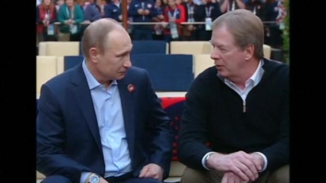 Russia's Putin pays visit to Team USA house in Sochi