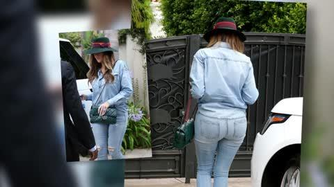 Khloe Kardashian Looks Somber in a Tight Double Denim Outfit