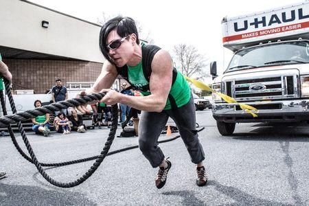 A participant in the May Queen Spring Strongwoman competition pulls a truck in Lancaster, Pennsylvania April 25, 2015. Courtesy of Amanda Kulik/Handout via REUTERS