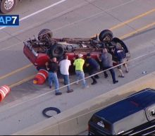 Good Samaritans rescue driver after pickup truck flips over on I-88