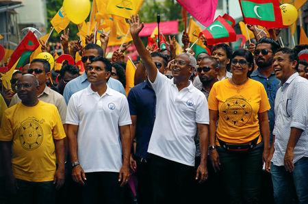 Ibrahim Mohamed Solih, Maldivian presidential candidate backed by the opposition coalition, waves as he stands next to his supporters during the final campaign rally ahead of the presidential election in Male, Maldives September 22, 2018. REUTERS/Ashwa Faheem/File Photo