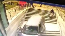 Double disaster as woman confuses steps for car park entrance