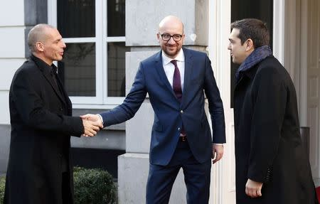 Belgian Prime Minister Charles Michel welcomes Greek Finance Minister Yanis Varoufakis (L) and Prime Minister Alexis Tsipras (R) ahead of a meeting in Brussels February 12, 2015. REUTERS/Francois Lenoir