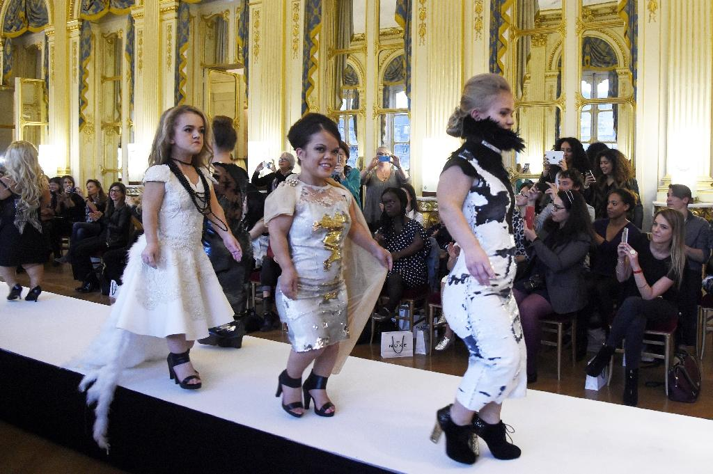 """Models present creations during the """"National Dwarf Fashion Show"""" on October 2, 2015 during Paris Fashion Week in Paris"""