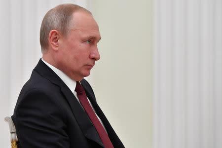 Russian President Vladimir Putin meets FIFA President Gianni Infantino in Moscow