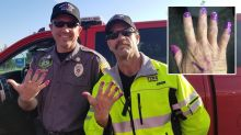Why two firefighters had their nails painted when attending a crash scene
