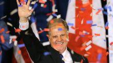 Doug Jones celebrates his victory in Alabama