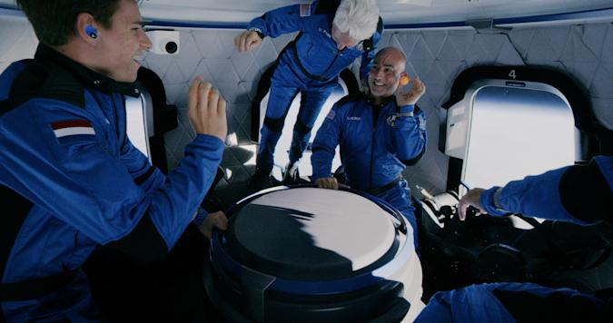 Image of Mark Bezos, Wally Funk and Oliver Daemen while in zero-g in Blue Origin's first flight.